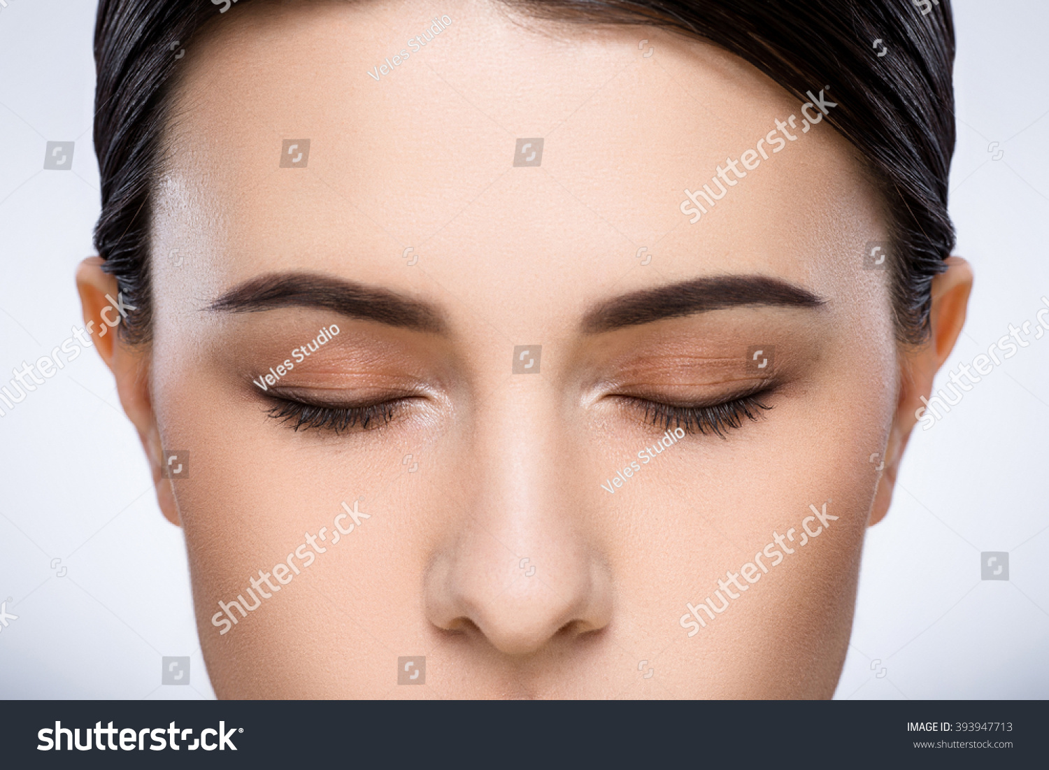 A Close Up Portrait Of Girls Dark Eyebrows Dark Hair And Light