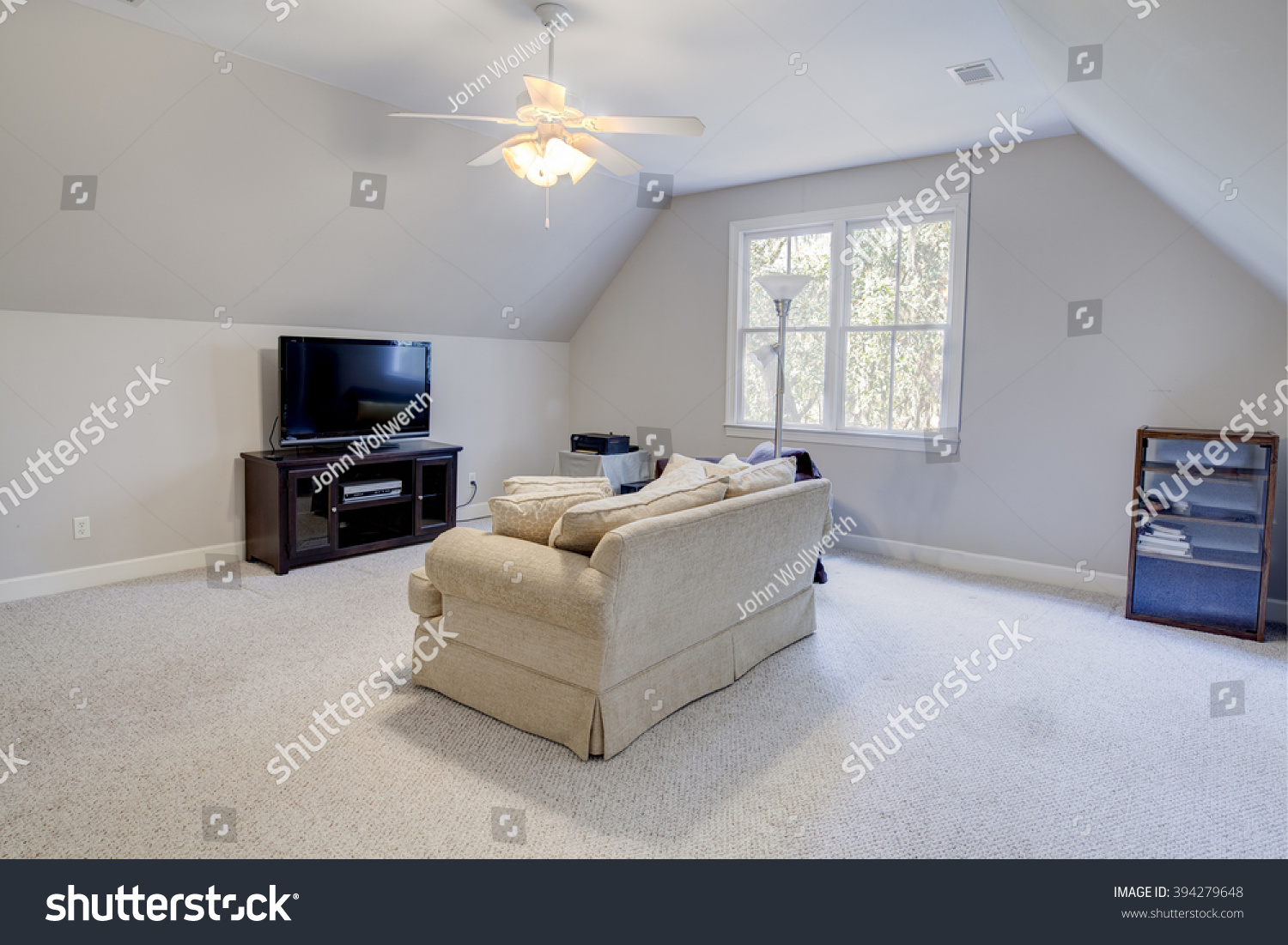 media room in attic of house with windows stock photo