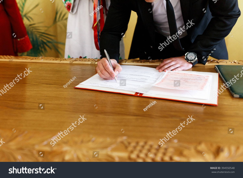 Traditional ukrainian bride groom signing certificate stock photo traditional ukrainian bride groom signing certificate in registry xflitez Choice Image
