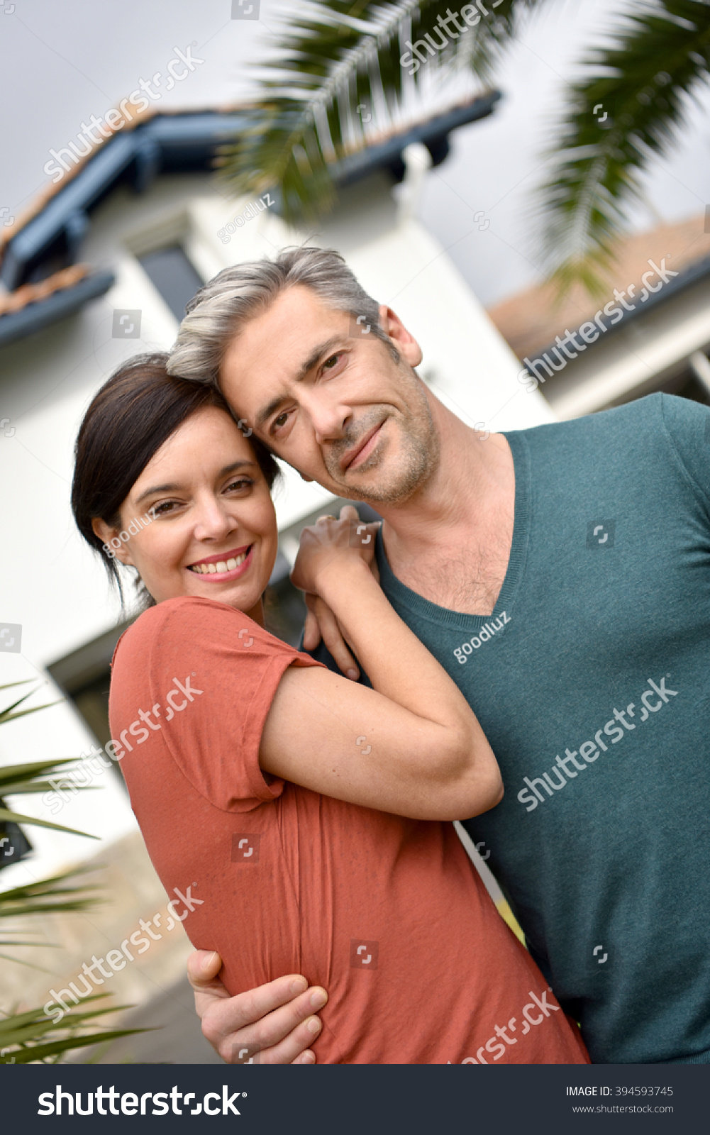 middleaged couple standing front new home stock photo edit now