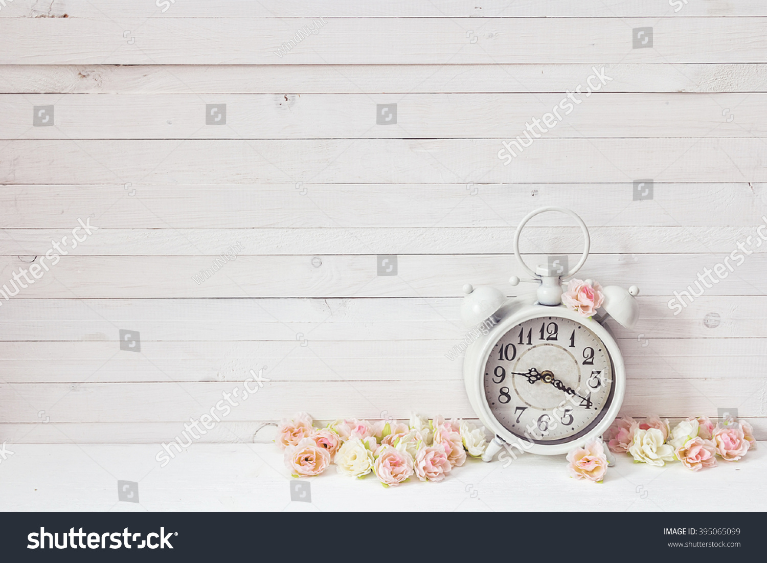 Background white alarm clock small pink stock photo 395065099 background with white alarm clock and small pink roses on white painted wooden planks place amipublicfo Image collections