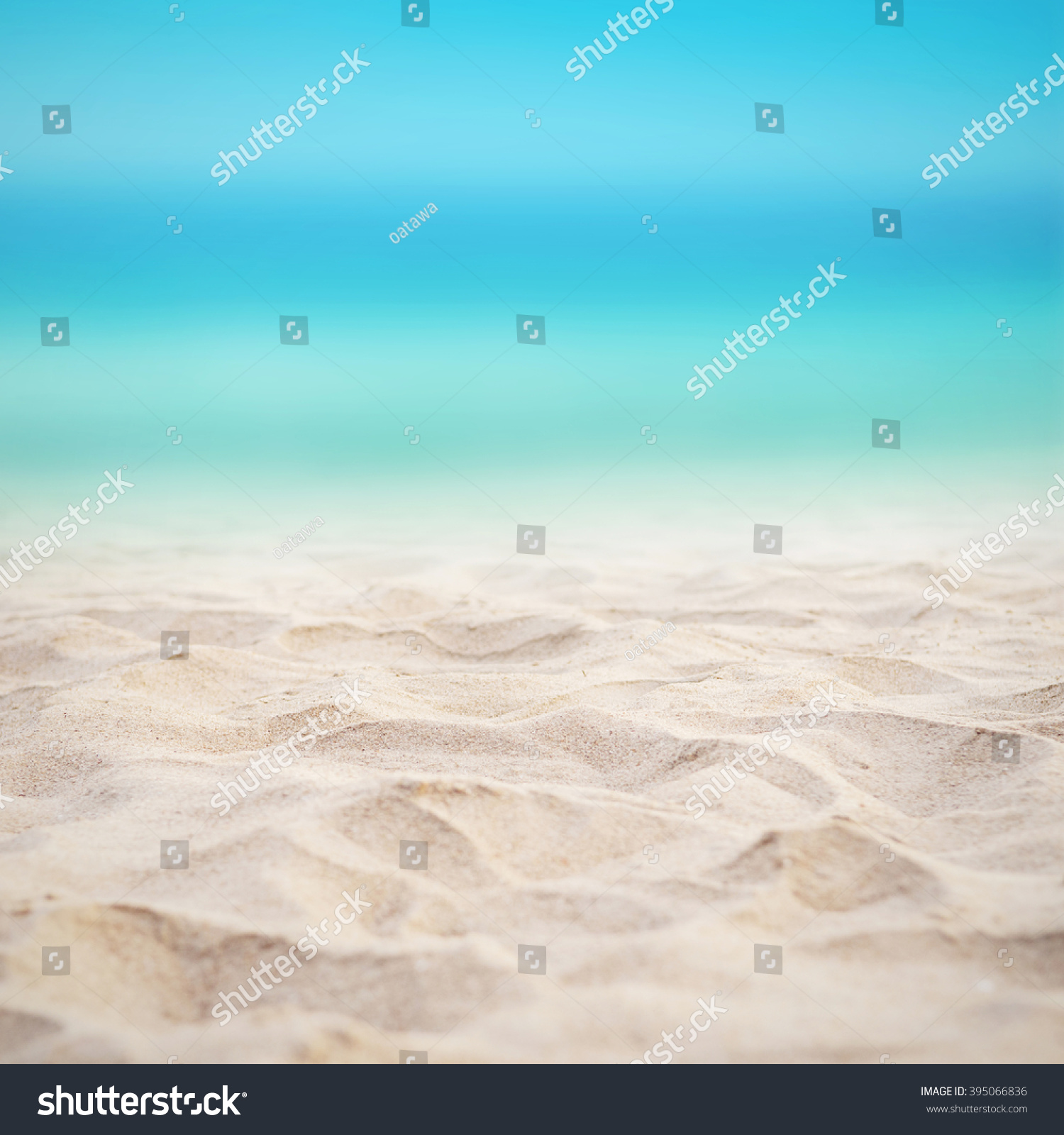 Sand Beach In Summer Sky Background: Close Sand Blurred Sea Sky Background Stock Photo