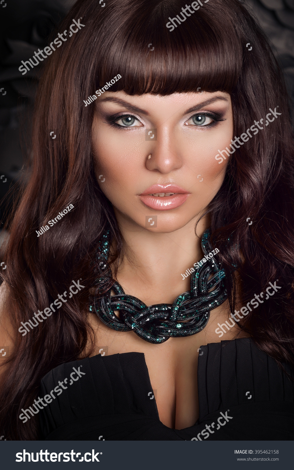 Fashion Studio Portrait Of Beautiful Young Woman With Long Dark Hair