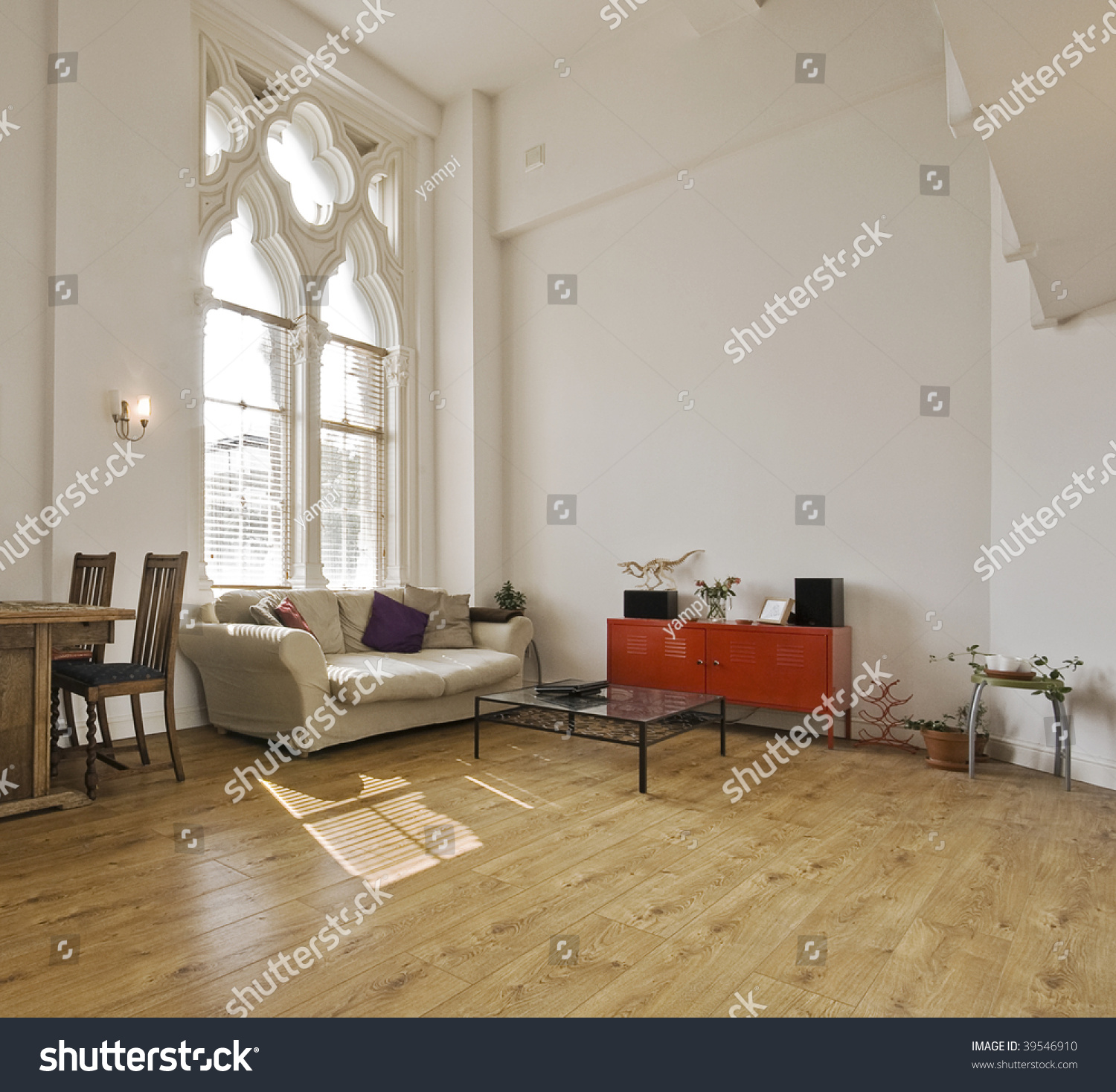 high ceiling apartment with large gothic windows stock photo 39546910