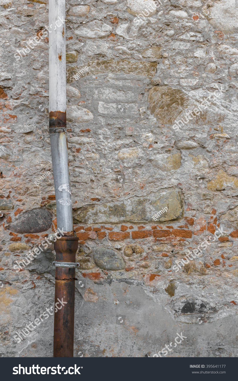 how to fix down pipe to brick wall