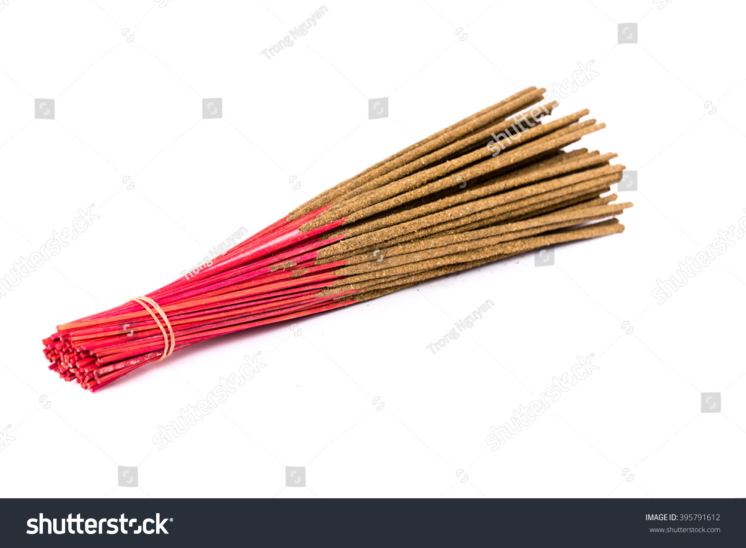 Close-up a bunch of incense sticks isolated on white Incense use in religious ritual popular in Vietnam.Its burned to intend as a sacrificial offering to various deity or to serve as an aid in prayer