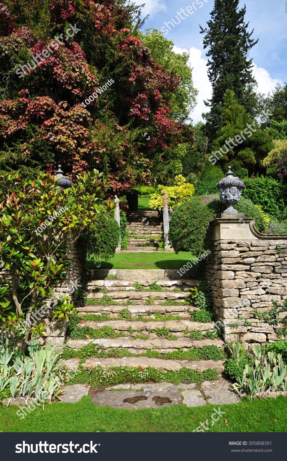 Stone Steps In A Beautiful English Landscape Garden