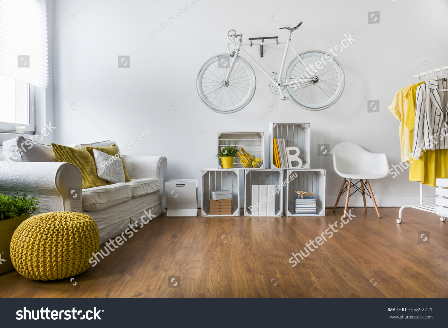 stock photo wooden parquet in big living room with comfortable white sofa and vintage decorations 395892721jpg