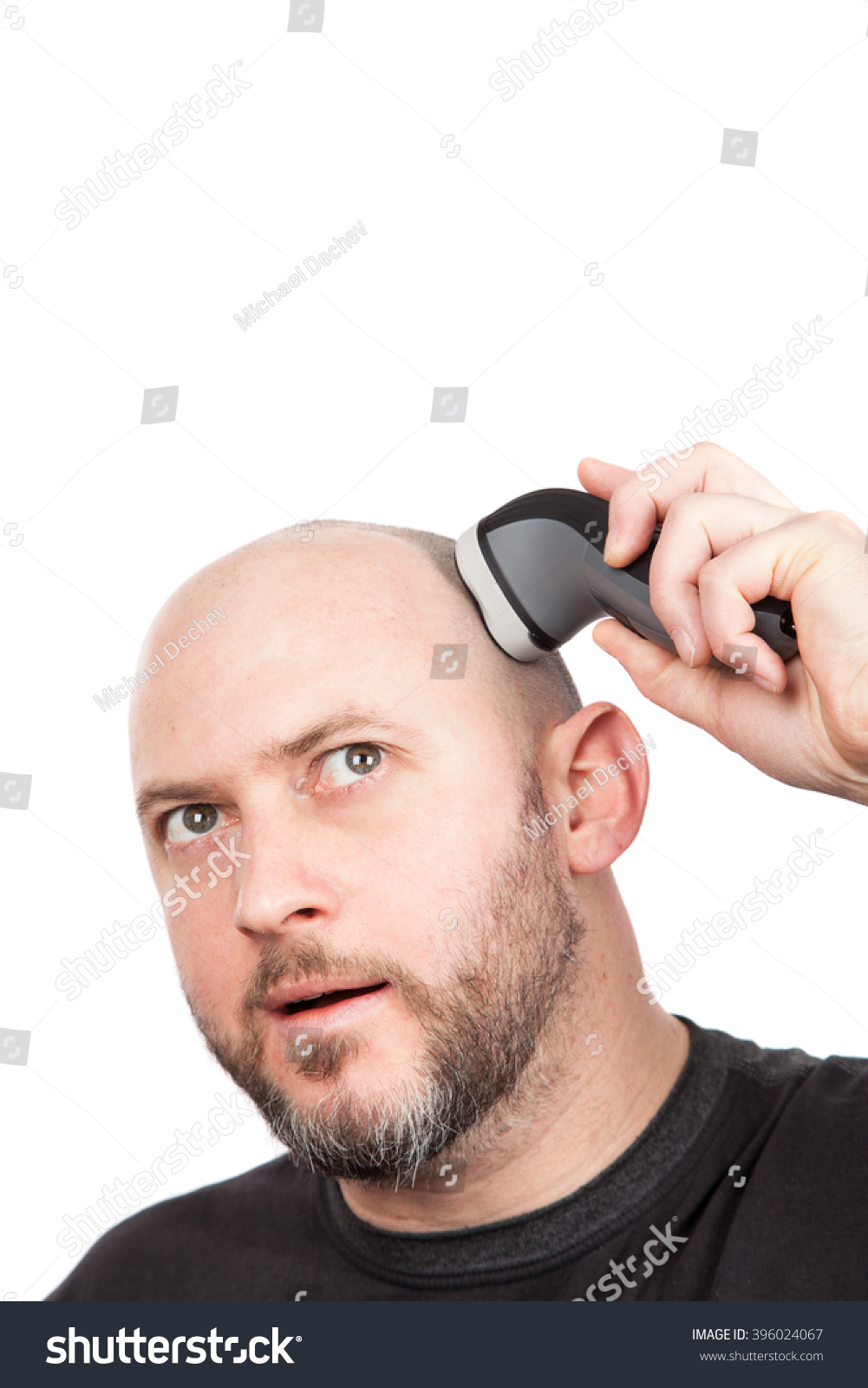 bald man with beard shaving his head with an electric shaver stock photo 3960. Black Bedroom Furniture Sets. Home Design Ideas
