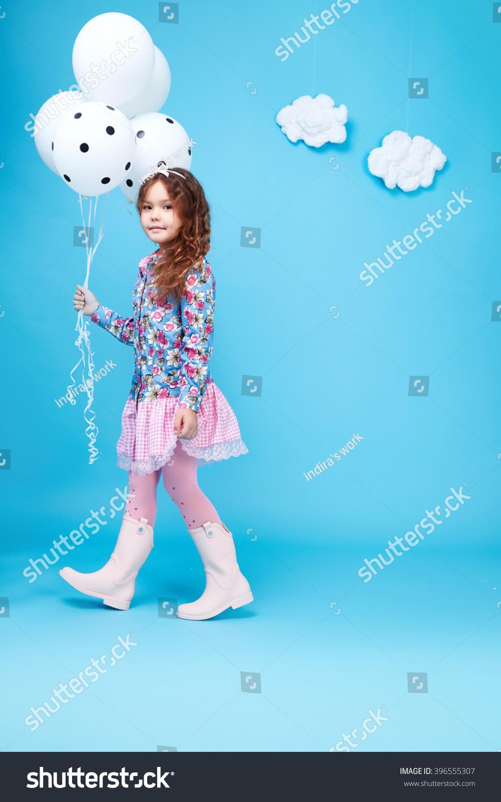 72e93f496 Beautiful little cute girl smile long dark hair take balloons wear style  fashion silk cotton dress spring mood children clothing childhood daughter  pretty ...