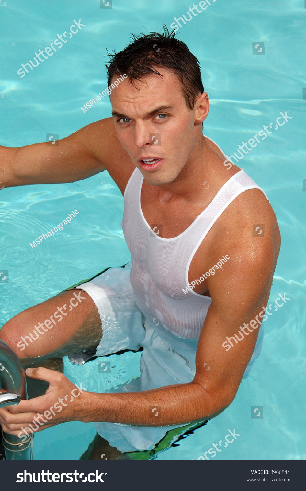 A Handsome Young Man Climbing Out Of The Swimming Pool Stock Photo 3966844 Shutterstock