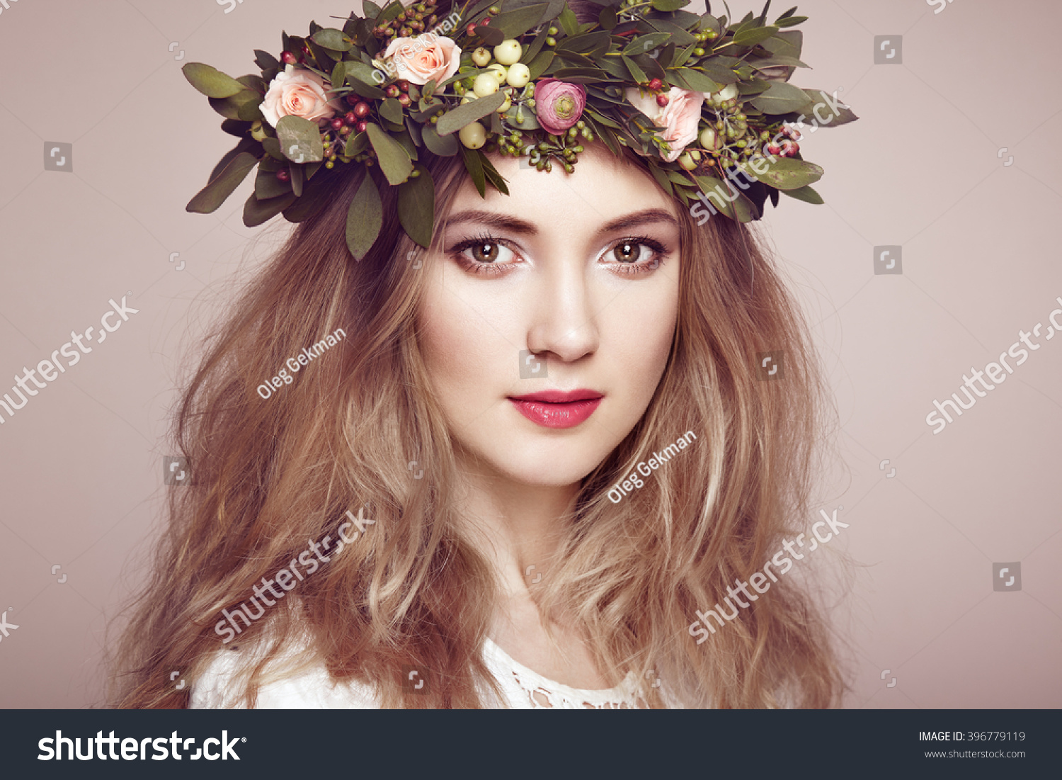Royalty free beautiful blonde woman with flower 396779119 stock beautiful blonde woman with flower wreath on her head beauty girl with flowers hairstyle izmirmasajfo