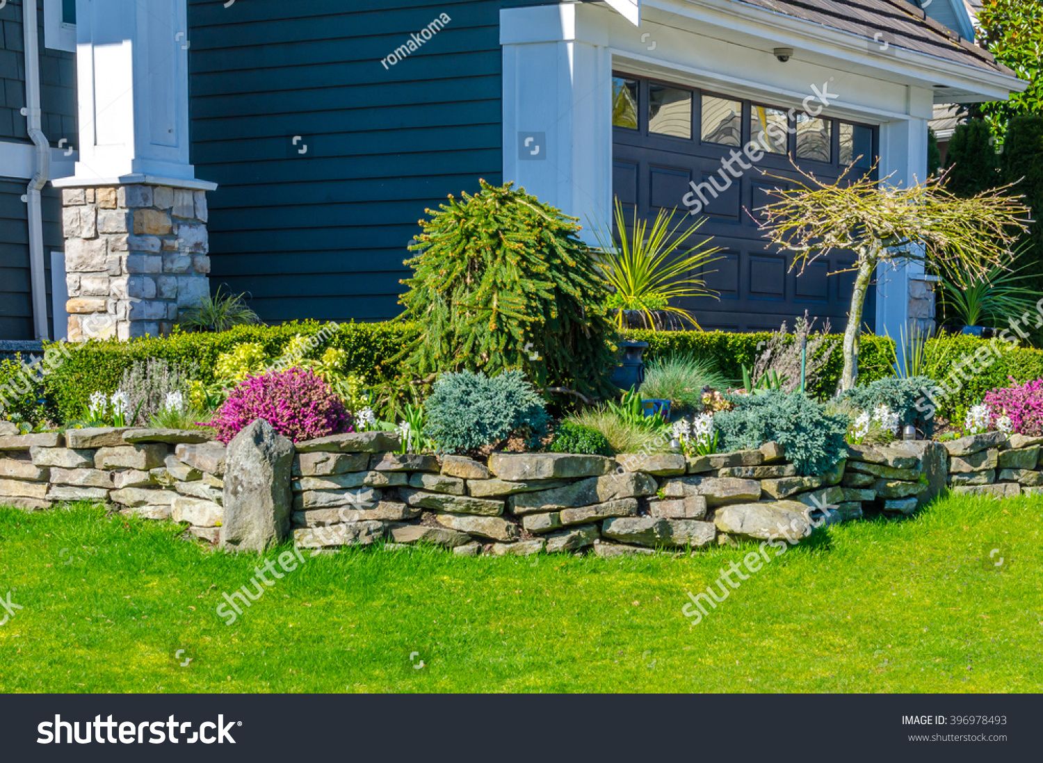 Nicely Trimmed Bushes Flowers Stones Front Stock Photo Edit Now 396978493