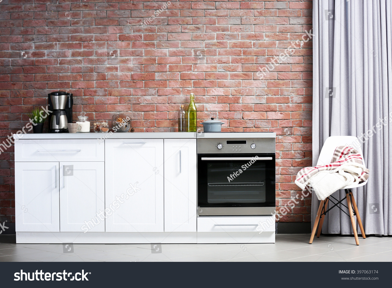 Modern Kitchen Furniture Against Brick Wall Stock Photo 397063174 ...