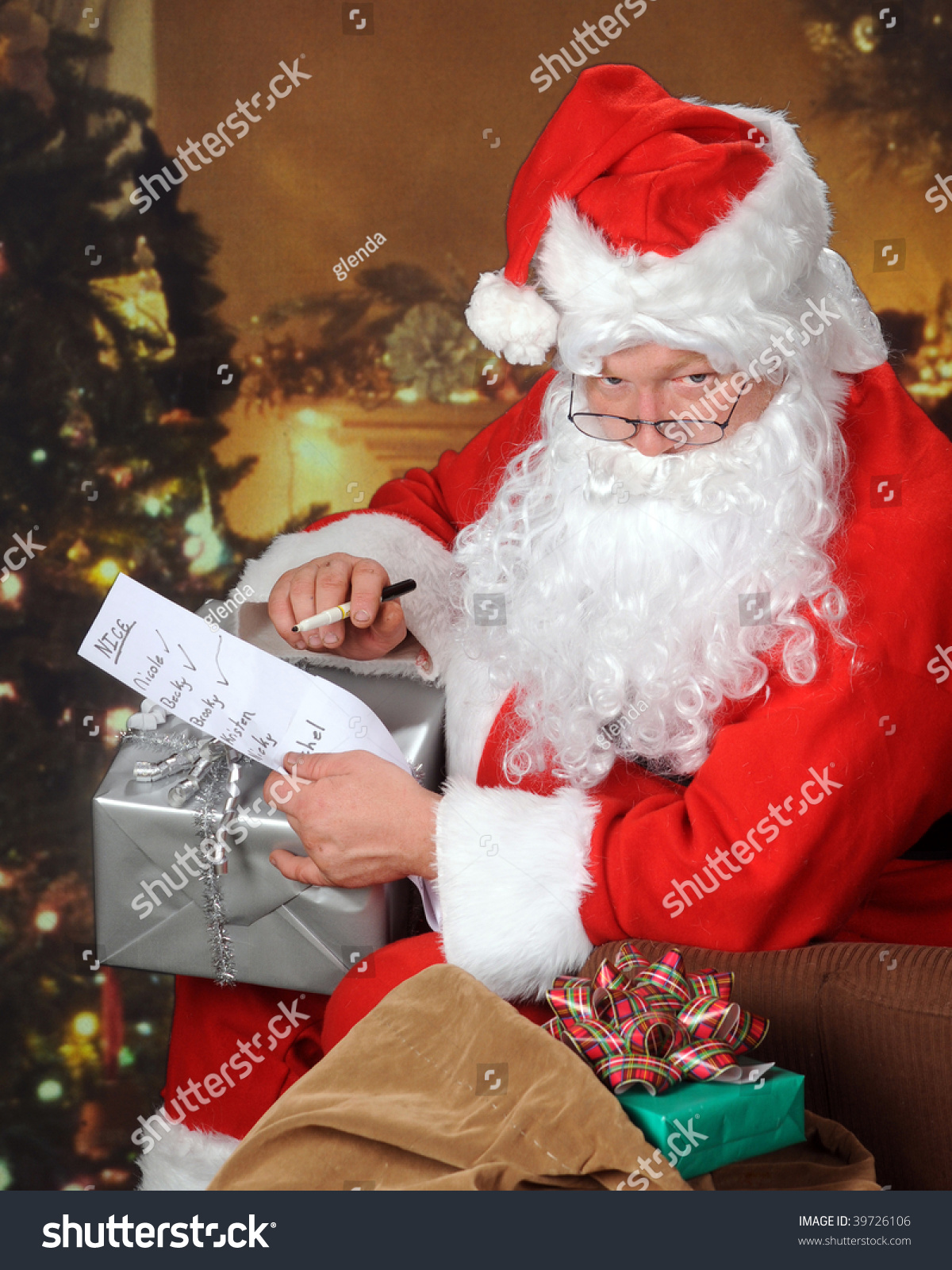 Santa With His Sack In A Decorated Living Room Glaring At The Viewer While Checking His Nice