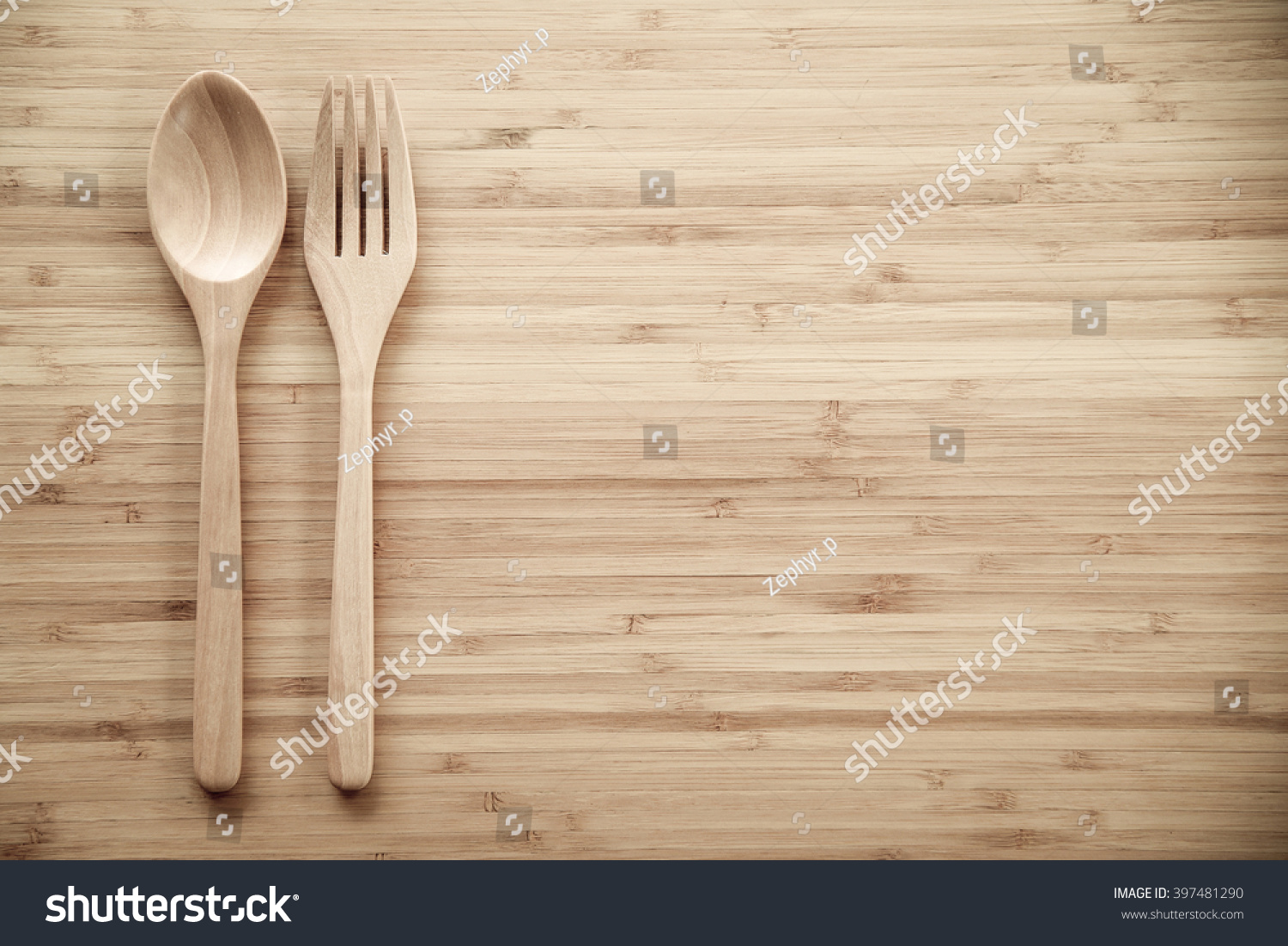 Spoon And Fork On Wood Texture Of Dining Table From Top View Use . Full resolution  img, nominally Width 1500 Height 1102 pixels, img with #926C39.