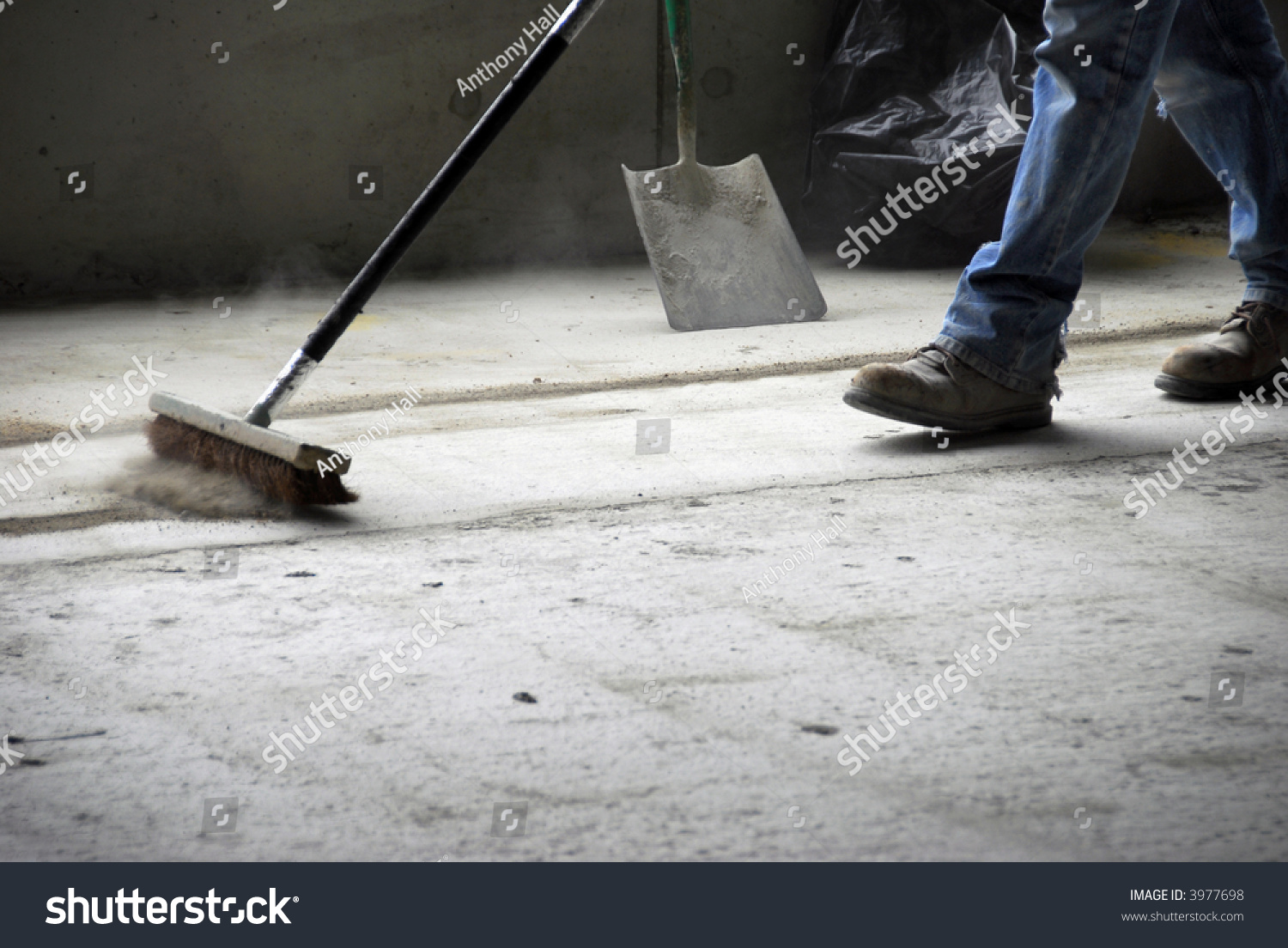 Legs Feet Construction Worker Sweeping On Stock Photo
