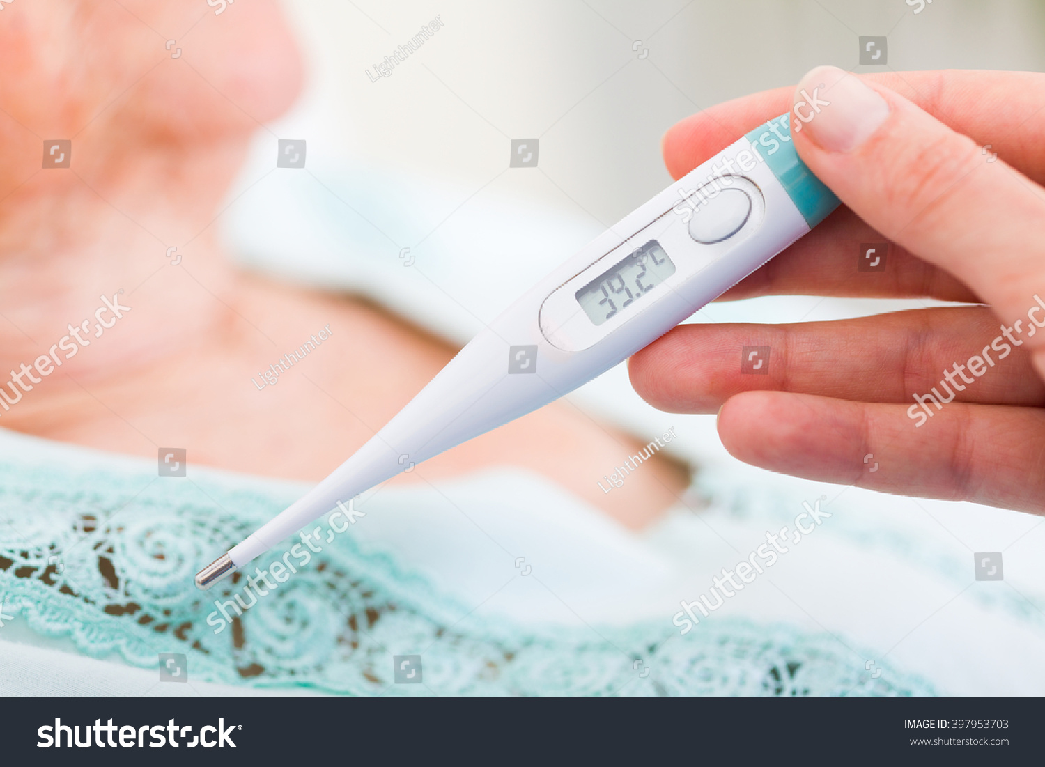 Nurse checking sick patients body temperature stock photo for Stress skin panels cost
