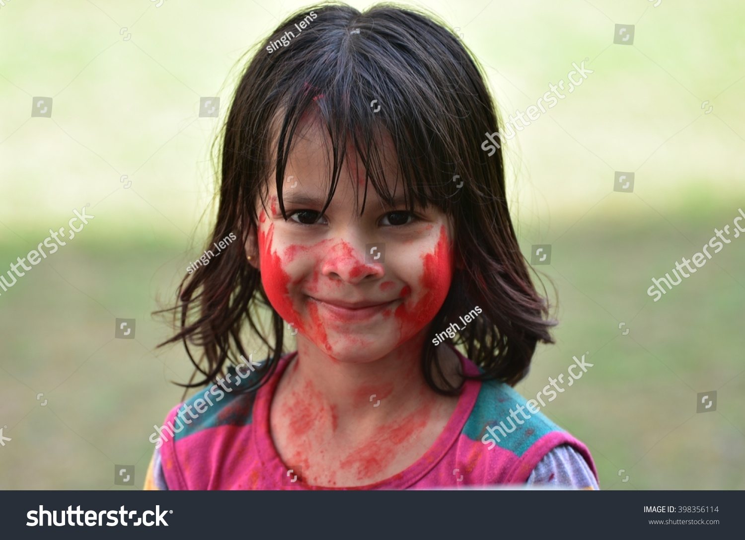 cute girl child portrait holi colors stock photo (royalty free