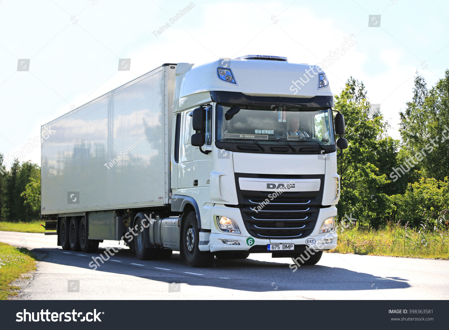 SALO FINLAND JULY 24 2015 New white DAF XF semi truck on summer road in Salo PACCAR reports strong revenues and net income for the Q3 of 2015