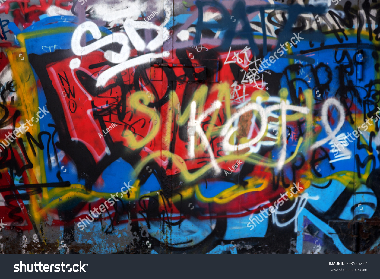 Beautiful street art of graffiti abstract creative drawing fashion on walls of the city