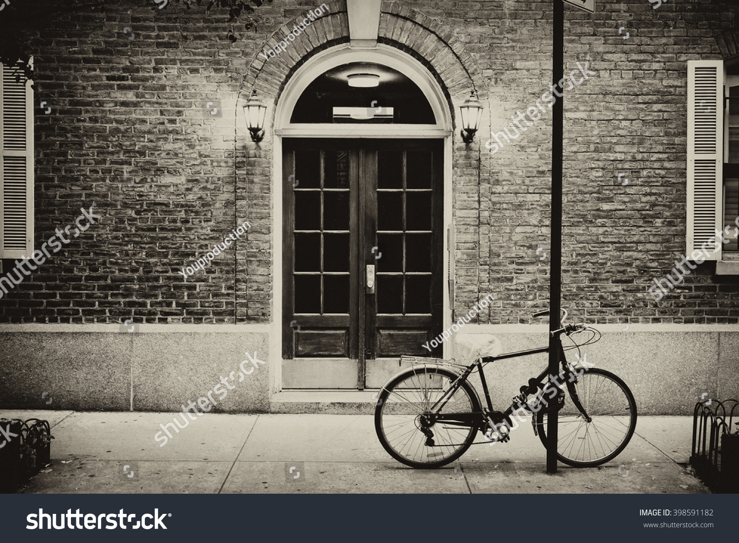 brick apartment building entrance. Beautiful building  Entrance door and bicycle Manhattan New York Classic apartment in Building Door Bicycle Stock Photo
