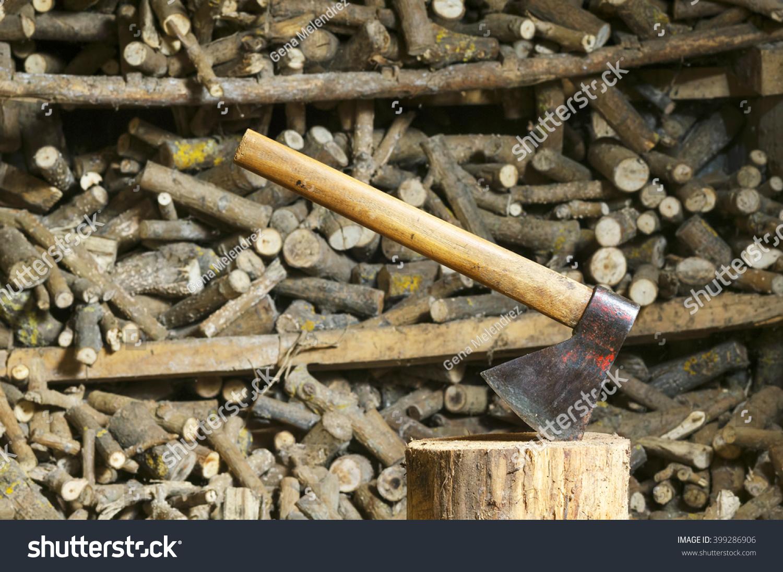 Old axe hatchet log unfocused firewood stock photo