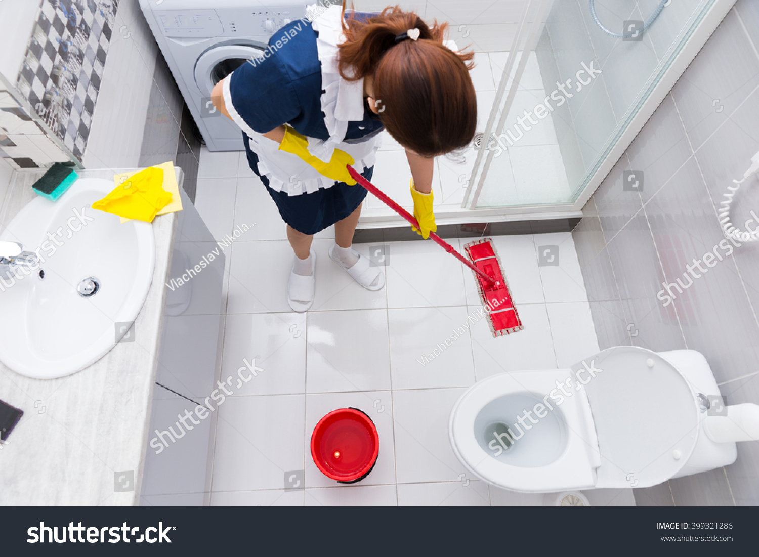 Housekeeper hotel mopping floor clean white stock photo for Bathroom cleaning procedure