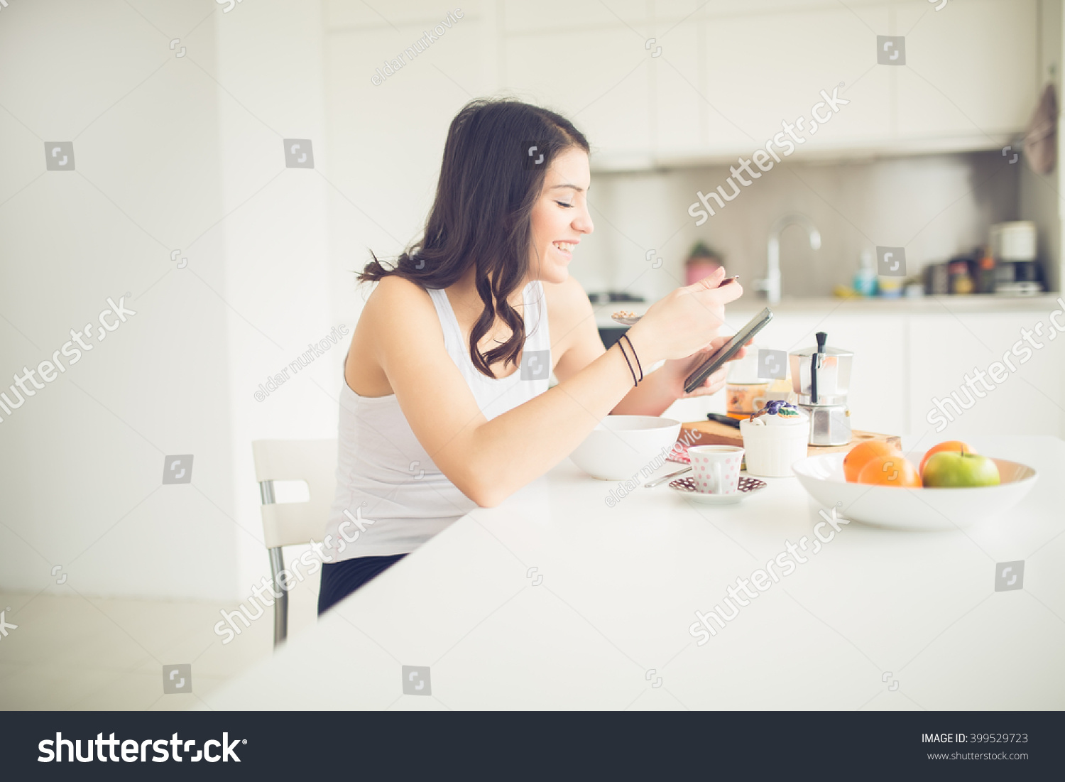 young smiling woman eating healthy breakfast stock photo 399529723 shutterstock. Black Bedroom Furniture Sets. Home Design Ideas