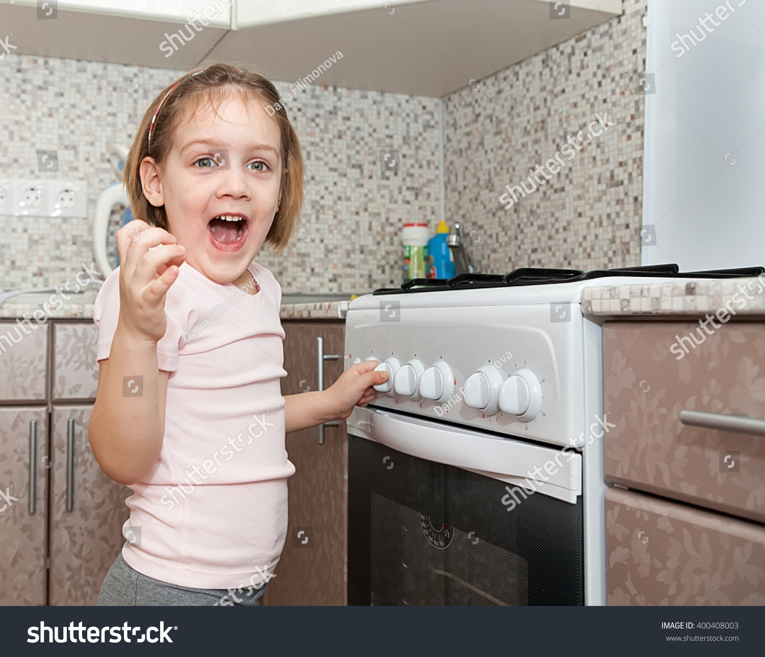 royalty child out supervision of parents  child out supervision of parents playing stove stock photo