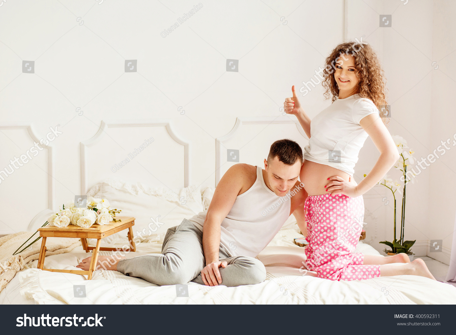 Beautiful couple love bedroom she pregnant stock photo for Love bedroom photo
