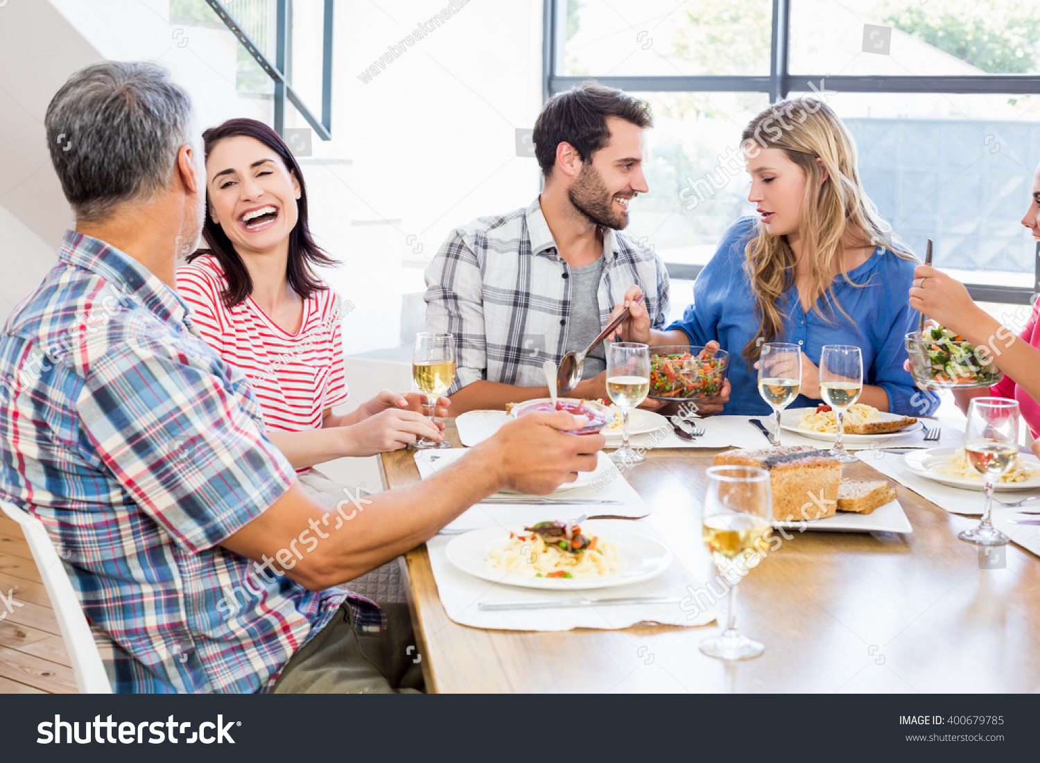 Friends Interacting While Having Meal Dining Stock Photo ...