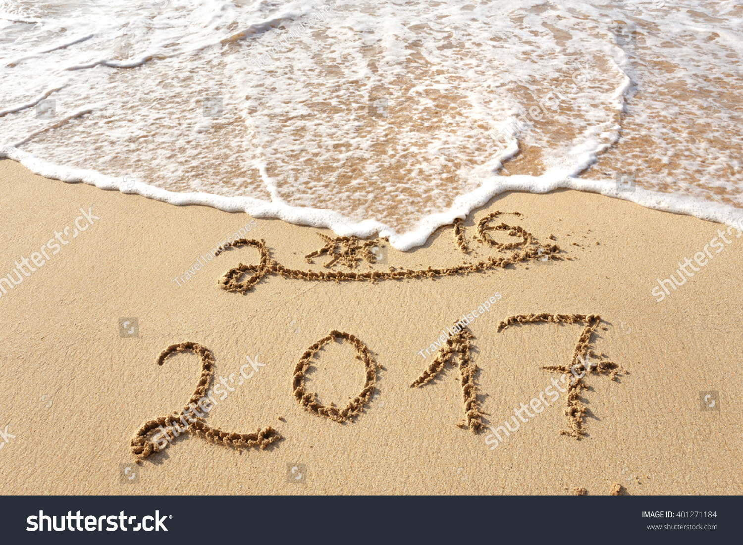 Happy New Year 2017 replace 2016 text on the sea beach #401271184