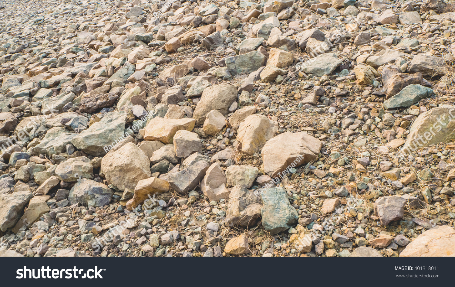 Dirt And Stone : Grey brown stone on dirt ground stock photo