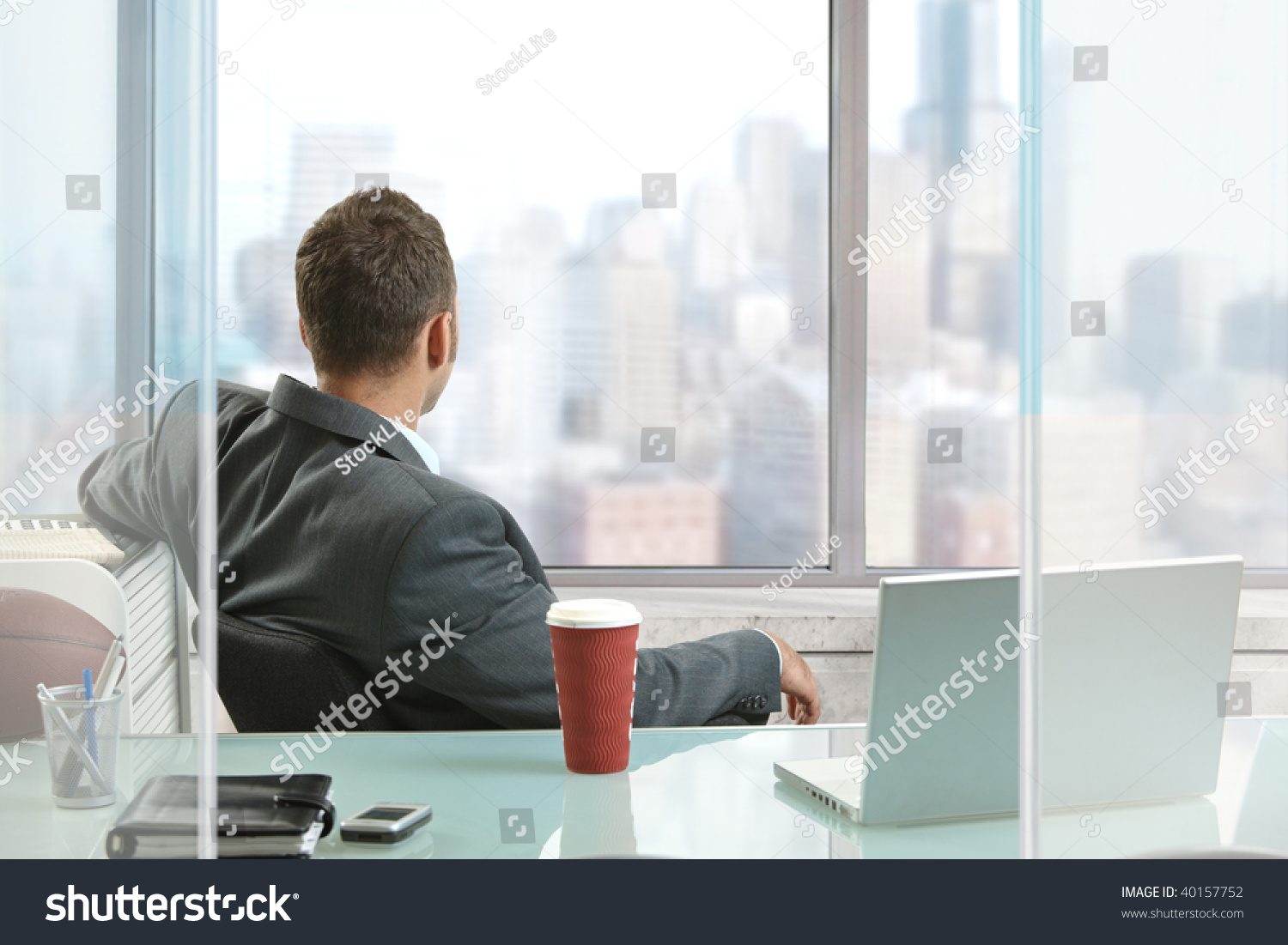 Relaxed Businessman Sitting Desk Office Looking Stock Photo ...