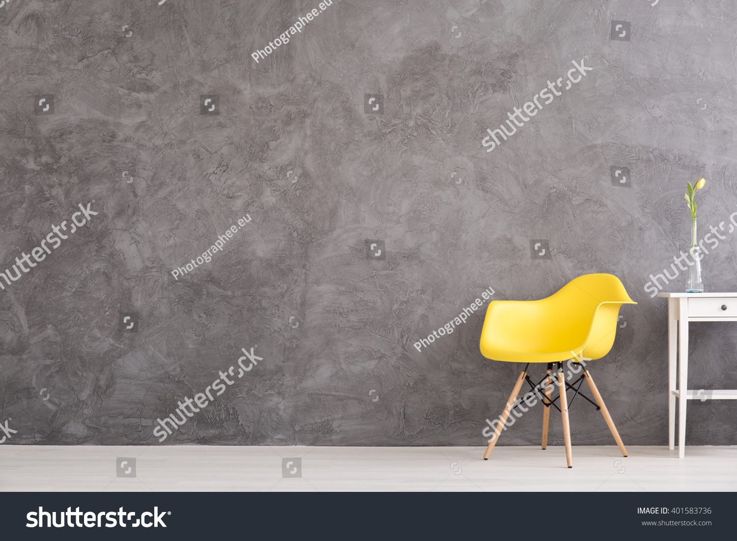 New Yellow Chair And Small, Decorative Table Standing In Interior With Grey  Wall