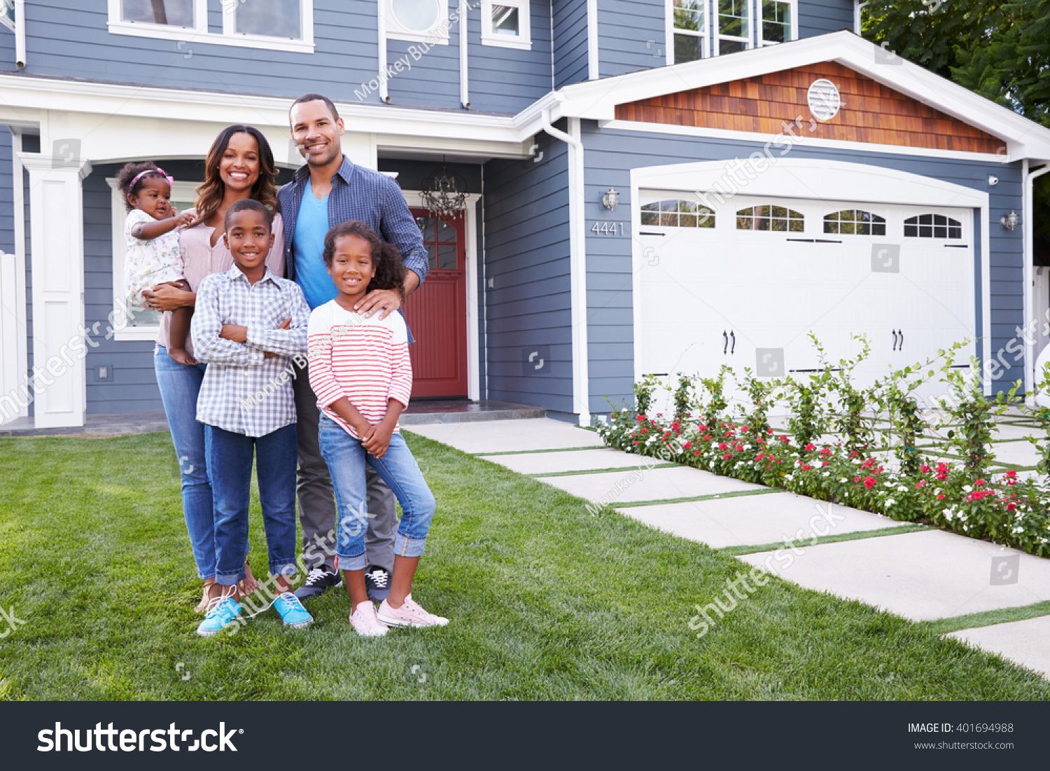 Happy black family standing outside their stock photo for Family in house