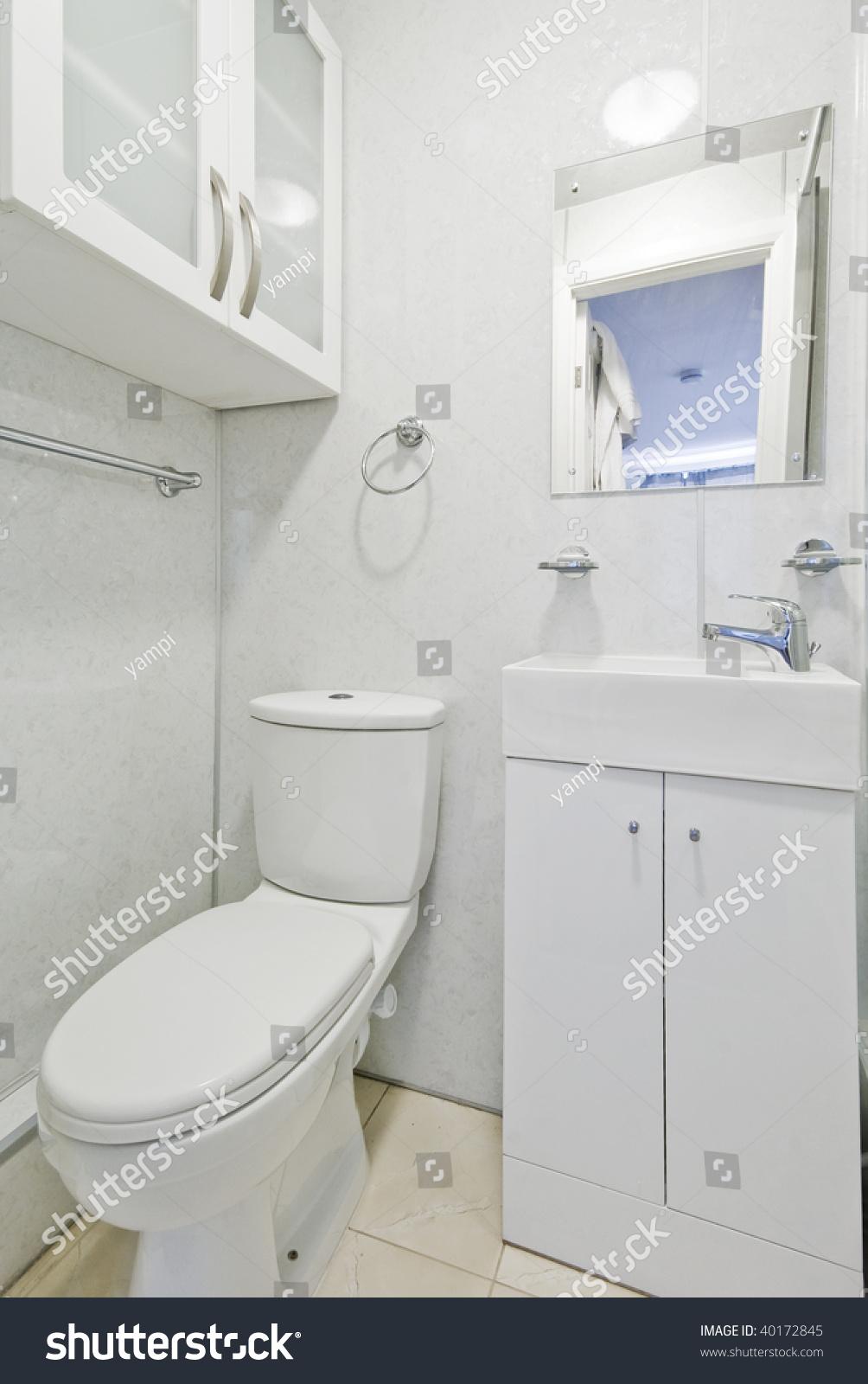 Modern white toilet bowl in the bathroom | EZ Canvas
