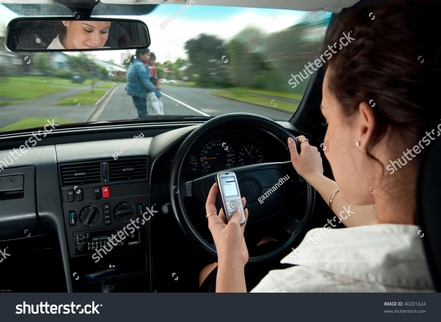 dangers texting while driving stock photo 40201624 shutterstock. Black Bedroom Furniture Sets. Home Design Ideas