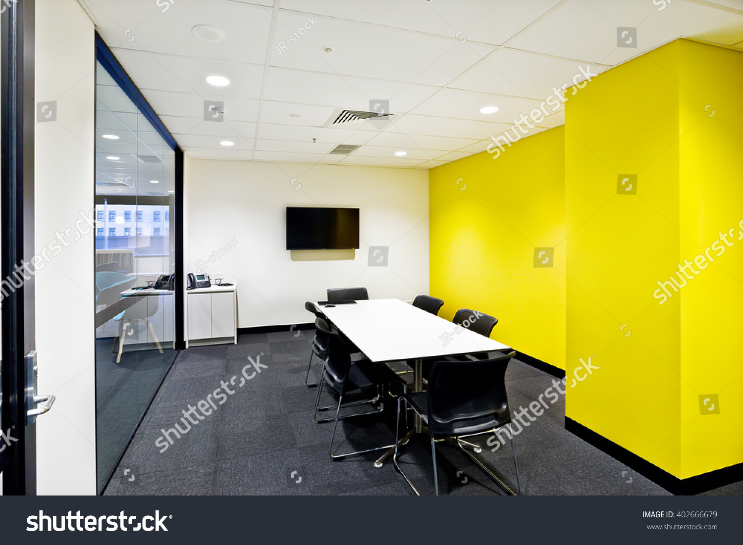 small meeting room yellow walls tv stock photo edit now 402666679
