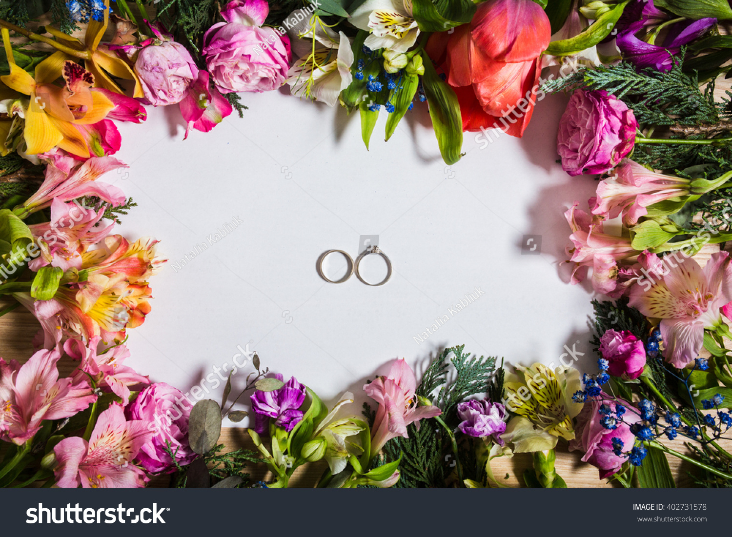 Top view blank page pink spring stock photo royalty free 402731578 top view blank page and pink spring flowers on wooden table background mightylinksfo