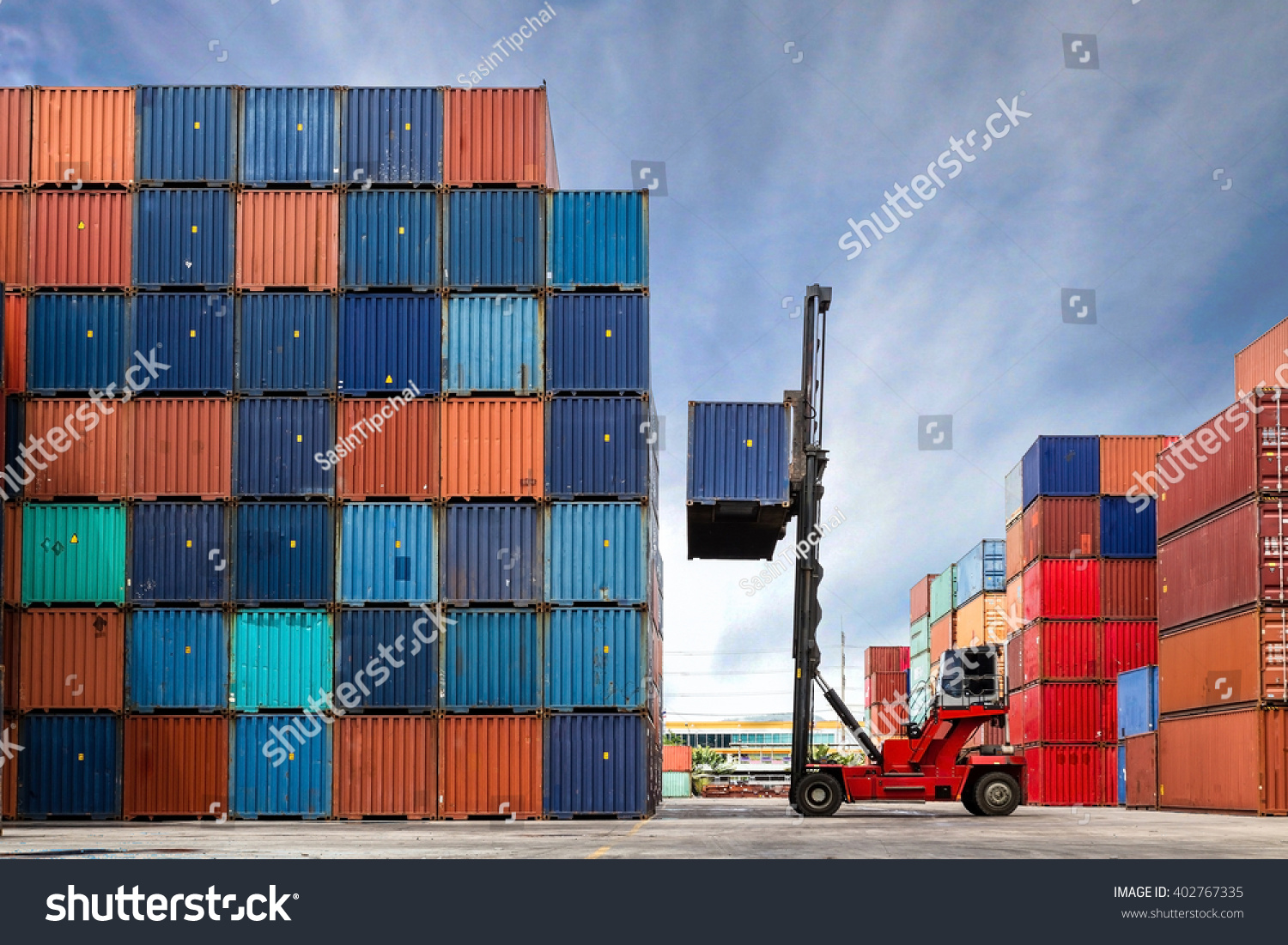 Crane lifting up container in yard #402767335