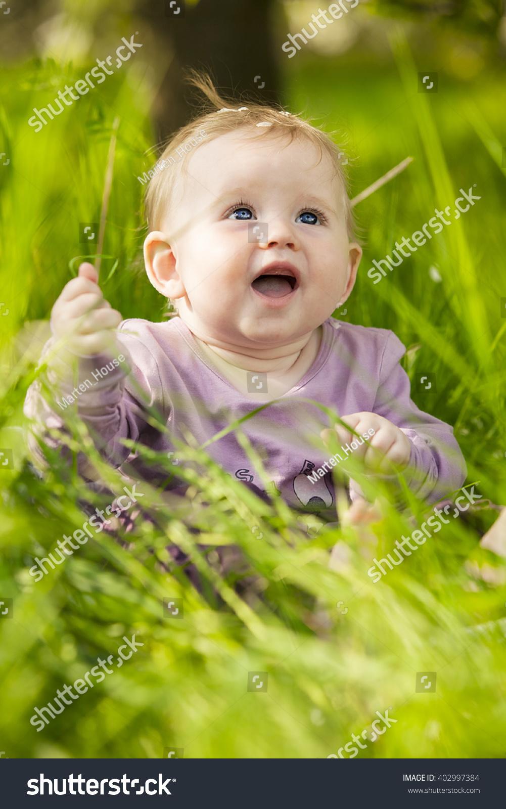 cute adorable nice baby girl green stock photo (edit now) 402997384