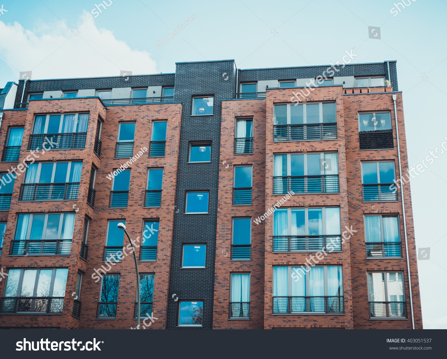 low angle view on modern residential brick apartment building
