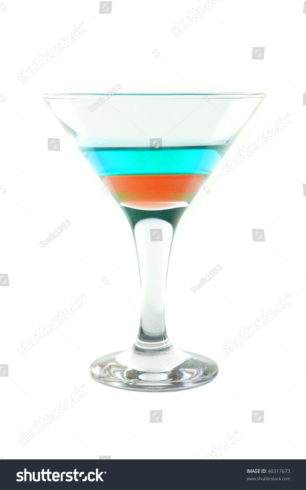 Cocktail with blue and orange layers isolated on white for Orange and blue cocktails