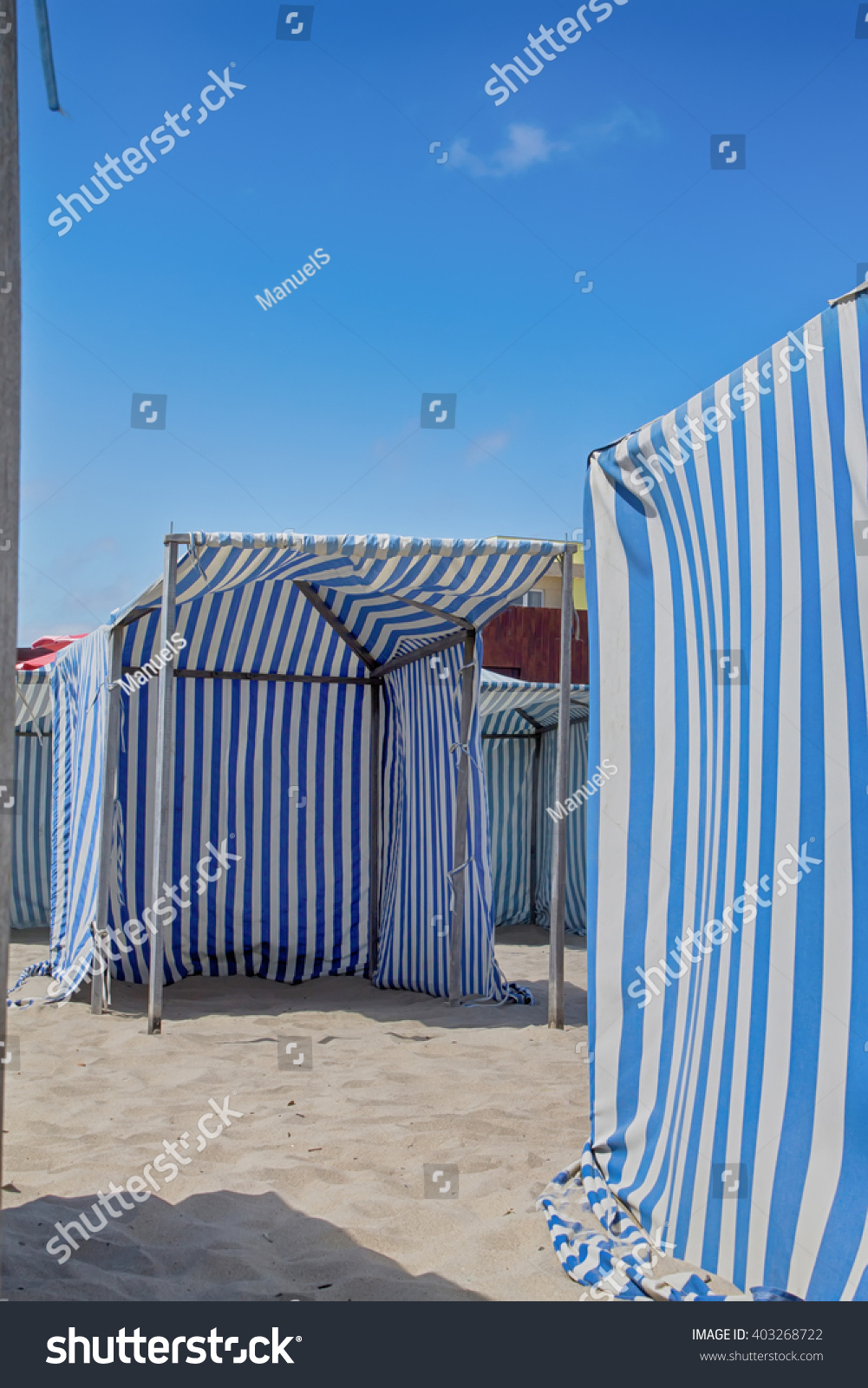Blue and white striped beach tent in the summer & Blue White Striped Beach Tent Summer Stock Photo 403268722 ...