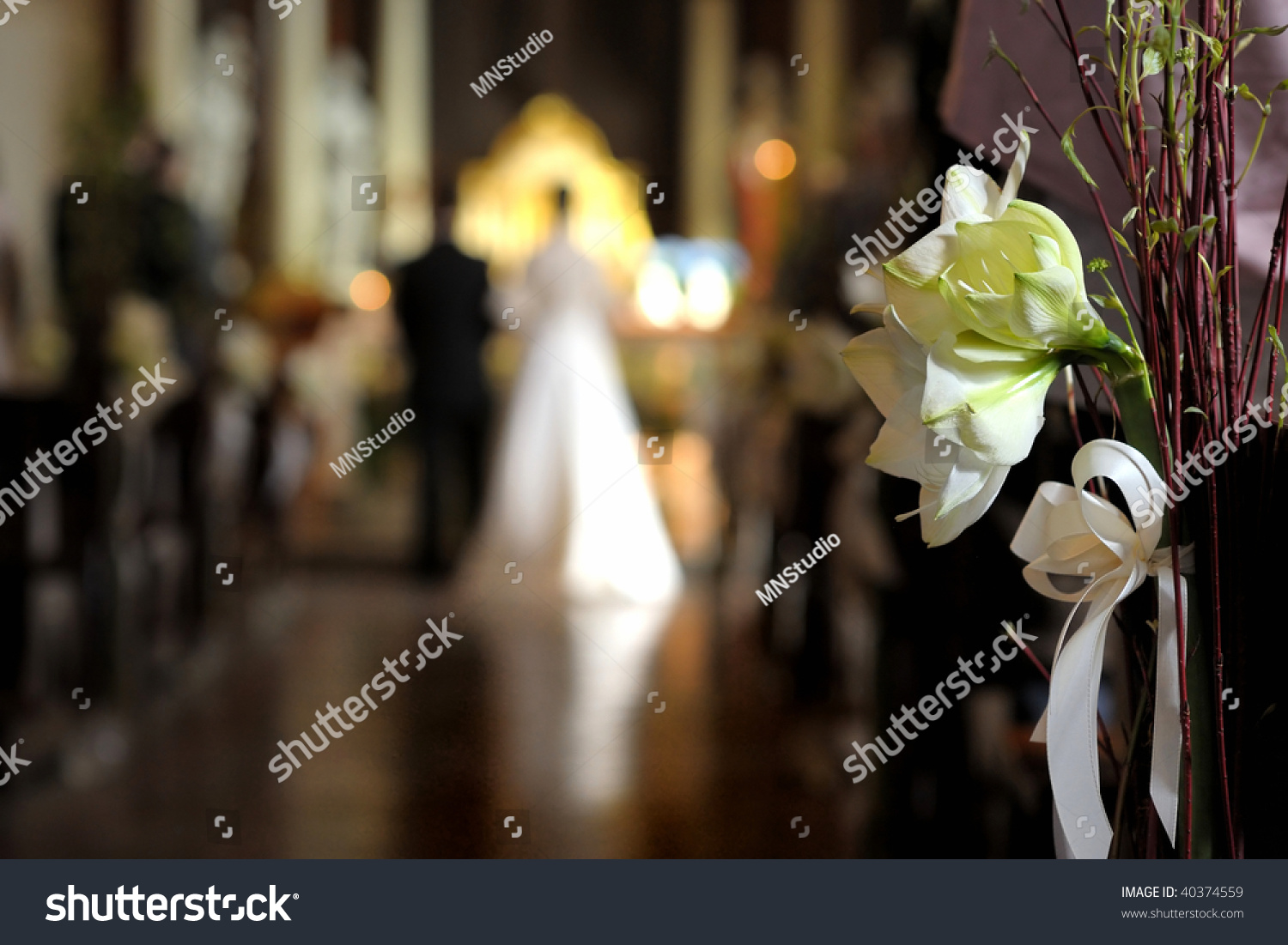 Flowers With A Wedding Ceremony In Background Stock Photo