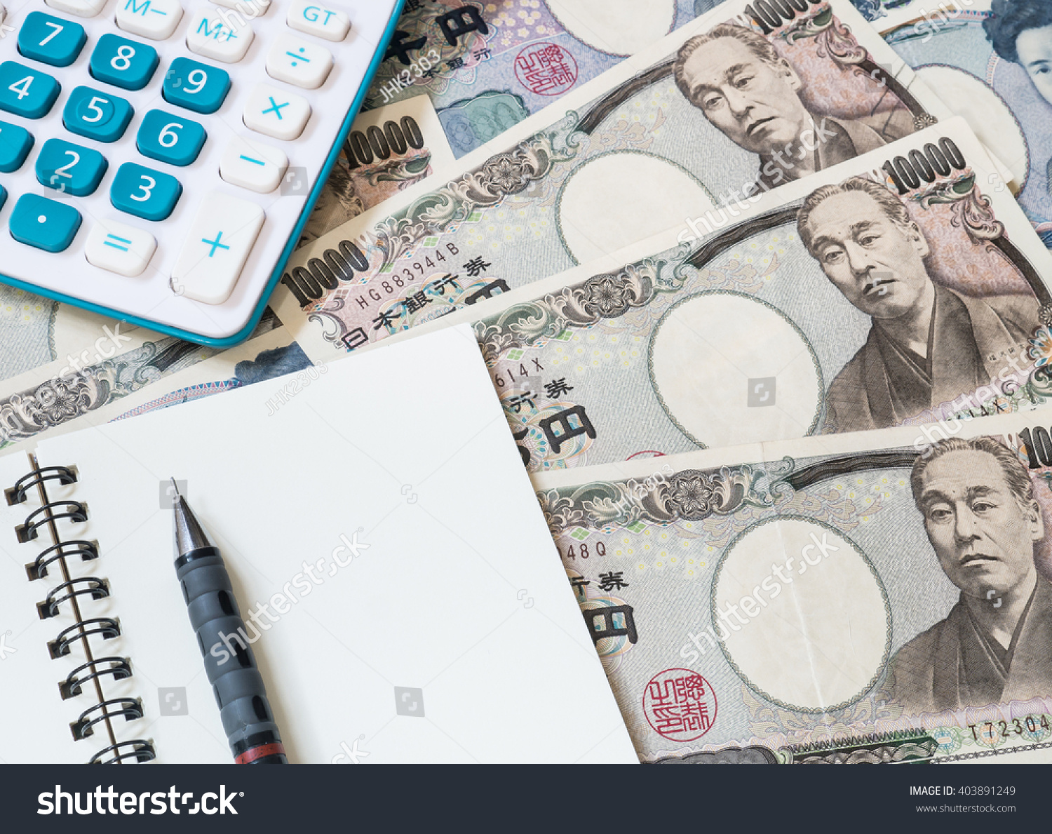 Japan money calculator notebook and pencil on japanese yen currency