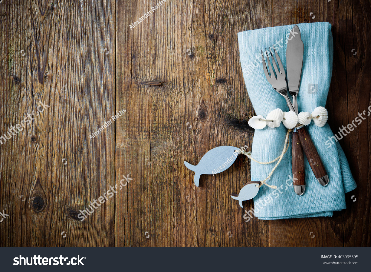 Fish Cutlery Tied With Empty Fish Shaped Tag On Wooden Table With Copy  Space.