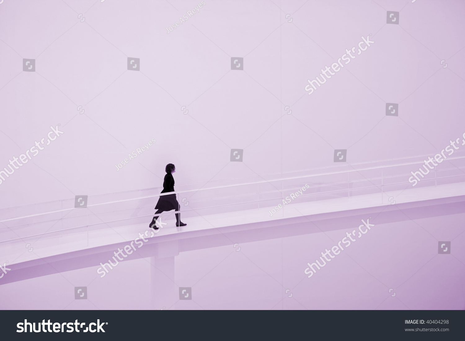 Young Woman Going Uphill On Empty Stock Photo 40404298